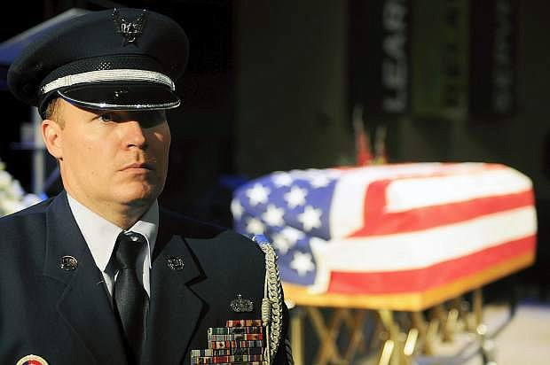 Master Sgt. Clinton Dudley, Nevada Air National Guard, stands watch in front of a casket holding Michael Landsberry, a fellow master sergeant in the Guard who was killed during a school shooting at Sparks Middle School. Landsberry was honored Sunday during a military ceremony at Sparks Christian Fellowship church.