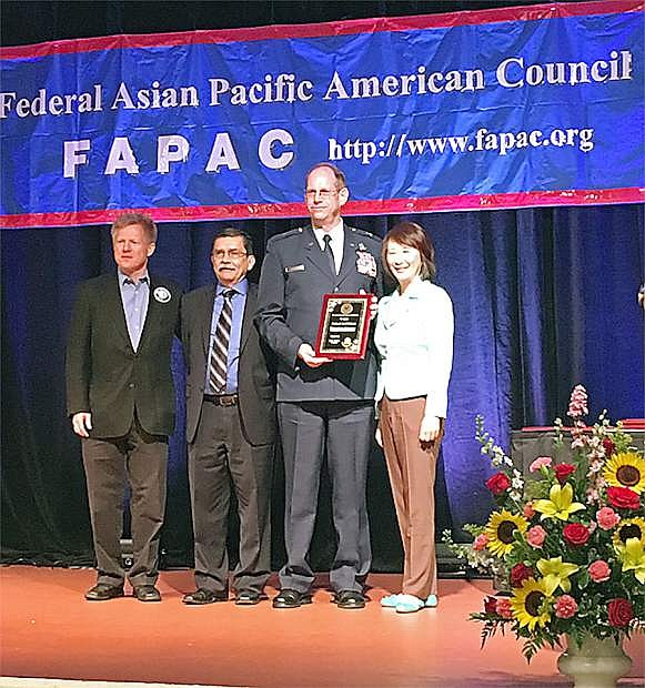 Nevada Adjutant General Brig. Gen. Bill Burks, second from right, receives his 2016 Federal Asian Pacific American Council Military Meritorious Service Award in Floriday during the 31st annual FAPAC National Leadership Training Program. Burks received the award from the organization in recognition of his contributions to the advancement of U.S. military missions and the promotion of equal opportunity in the Asian American and Pacific Islander communities.