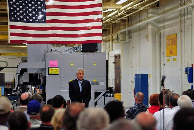 Secretary of Defense Chuck Hagel speaks to sailors and Department of Defense civilian employees at Fleet Readiness Center Southeast during a tour of Naval Air Station Jacksonville.