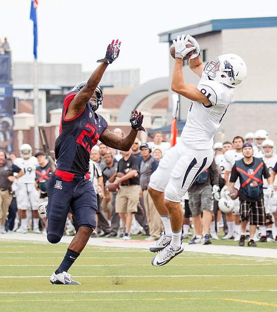 Nevada freshman Victor Gonzalez tries for a second-quarter reception Saturday against Arizona cornerback Jarvis McCall in the Wolf Pack's loss to the Wildcats last Saturday, Sept. 12, at Mackay Stadium.