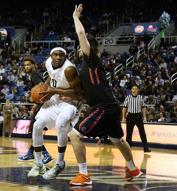 Nevada's Cameron Oliver posts up against Boise State's Nick Duncan.