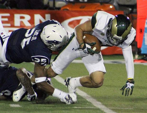 Nevada linebacker Byan Lane Jr. tackles CSU wide receiver Joe Hansley short of a first down late in the second half.