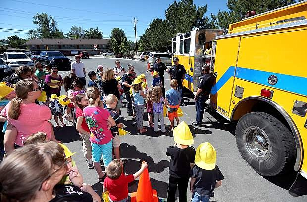 Carson City firefighters talk with local kids at a special Carson City Library Storytime on Thursday, July 24, 2014. This year's Summer Reading Program theme is Community Heroes featuring local agencies like Carson City Fire, Sheriff's Department and the Nevada National Guard.