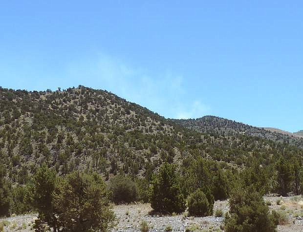 Smoke rises in the Pine Nut Mountains after a fire was reported at about noon on Wednesday.