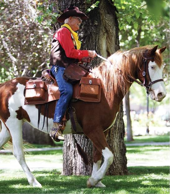 Bob Moore rides onto the grounds of the Nevada State Capitol on Thursday.