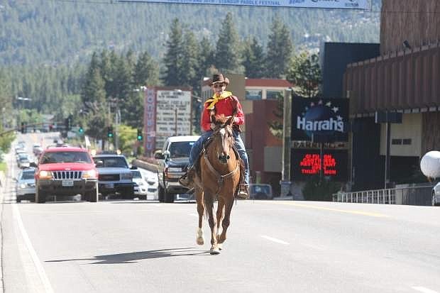 Bob Moore rides Casey on Highway 50 at Stateline during the annual Pony Express re-ride in 2013.