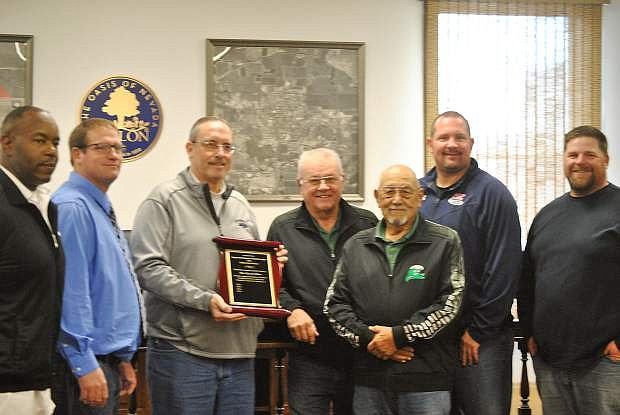 Don Kidd, left, stands with Robert Bates, Mayor Ken Tedford Jr., Ralph Ratti, Don Hardy, Gary Archie, and Jim Taylor after presenting the mayor with this award.