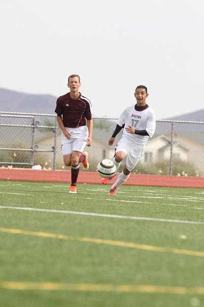 Dayton's Jaime Avila chases down a loose ball against Elko on Saturday.