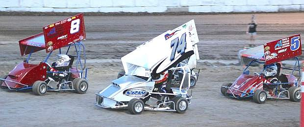 The Outlaw KART racers show their grit during Saturday's action at Rattlesnake Raceway.