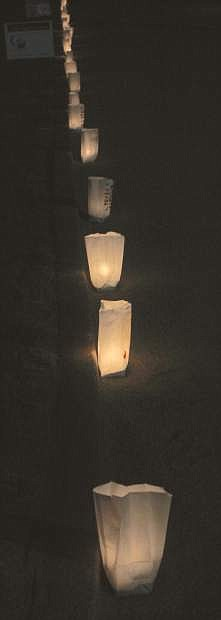 Luminaria bags, which honor someone who survived cancer or died from the disese, light up the track.