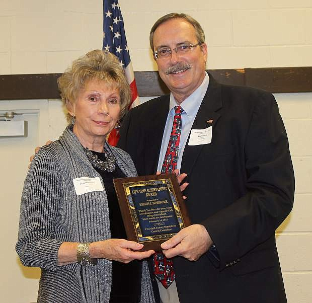 Maor Ken Tedford, Jr., right, presents a plaque to Paula Domonoske, who accepted on behalf of her husband Mert. Mert Domonoske, who is retired, served in the Fallon City Council and as mayor,owned his own business, belonged to numerous organizations and fought in World War II with the  U.S. Army.