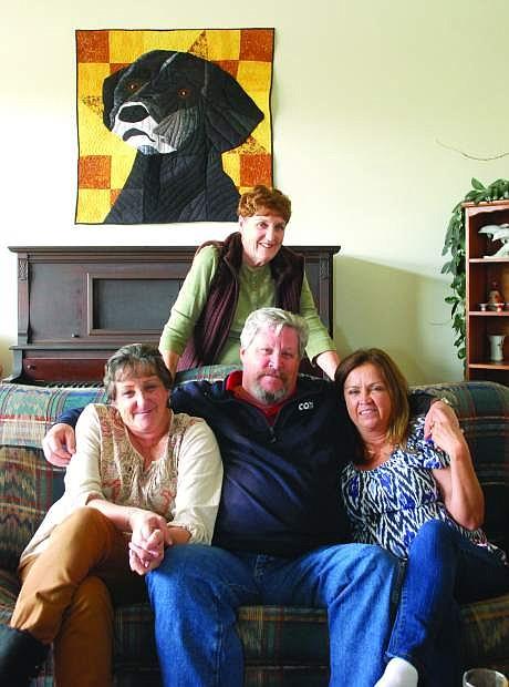 Mother Susan Lederer of Fallon stands behind her children, from left, Casey Collins, John Collins Jr. and Perline Porter.