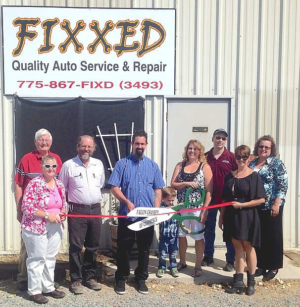 Fixxed had a recent ribbon cutting. From left are   Chamber board member Ava Case, John Towell, Champer President Grant Mills, Troy Seay, Corbin Seay, Shelbe Seay, Chamber Executive Director  Natalie Parrish and Kim Klenakis, CEDA.