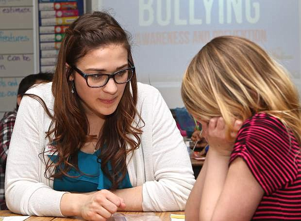Kylie Schmid chats with 2nd grader Lily Broon on Friday at Mark Twain Elementary School.