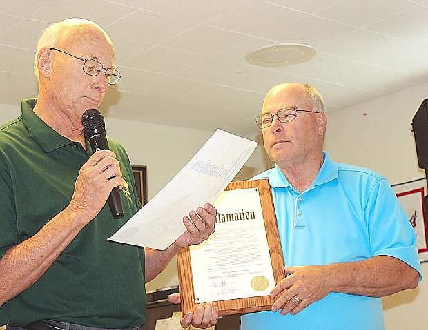 Fallon Councilman Bob Erickso, leads,n reads a proclamation Friday recognizing National Senior Citizen Day. Holding the proclamation is Churchill County Commissioner Bus Scharmann.