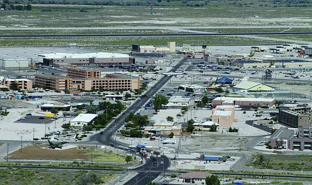 Sequestration at Naval Air Station Fallon has begun and will affect more than 400 federal workers and curtail some operations.