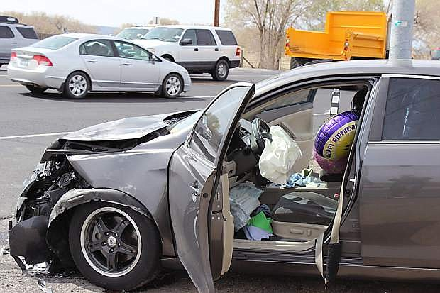 A Toyota Camry was hit when a pickup failed to yield the right away when crossing the Reno Highway.
