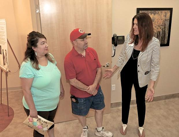 Carson-Tahoe Breast Center COO Michelle Joy chats with Curtis and Ann Marie Yow of Carson City Thursday evening at the center's open house.