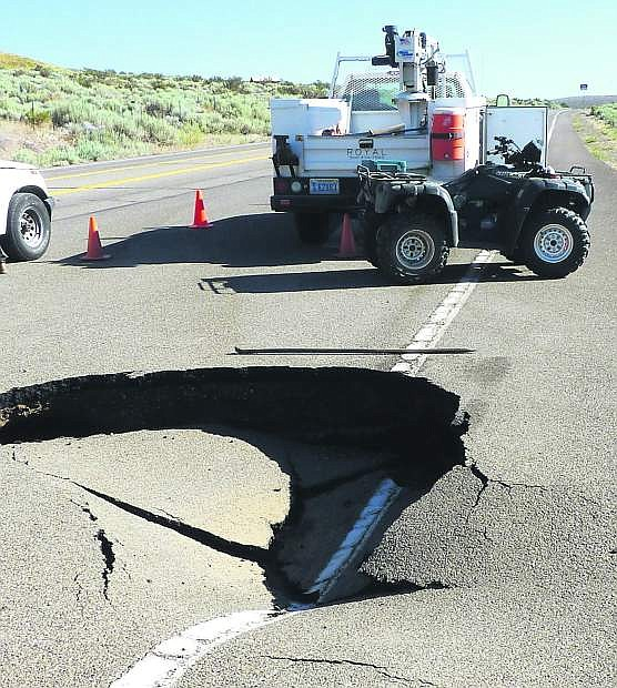 A sink hole on Jacks Valley Road north of Genoa was caused by a broken water line.