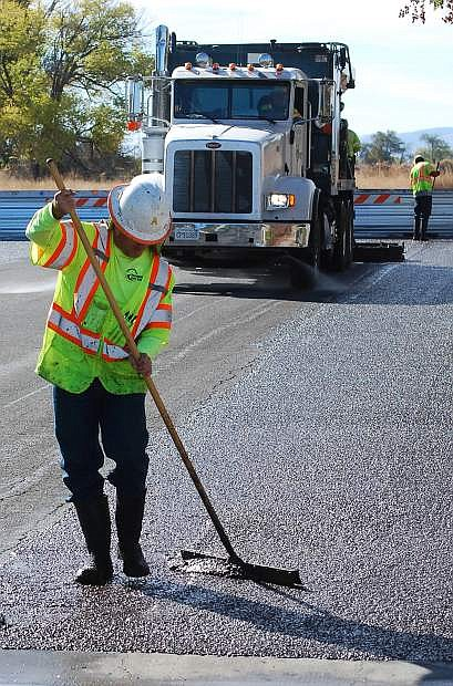 Workers began covering city streets with slurry seal on Tuesday. The project is being done by Intermountain Slurry Seal, Inc., which is located in Sparks.