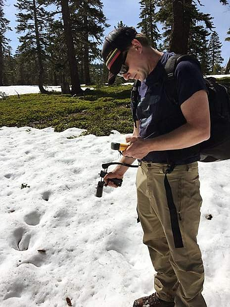 Ecohydrologist Adrian Harpold from the College of Agriculture, Biotechnology and Natural Resources takes measurements of the Sierra Nevada mountain snowpack. He studies impacts of the Sierra Nevada mountain snowpack on streams, rivers and reservoirs.