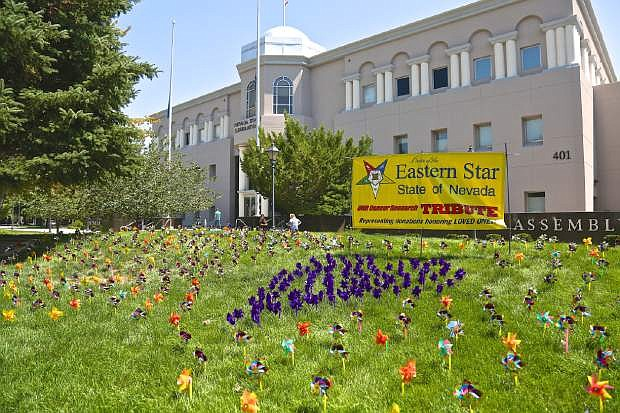 Hundreds of pinwheels adorn the lawn of the Legislative Building Wednesday signifying the donations to UNR's cancer research honoring loved ones in the battle against cancer.