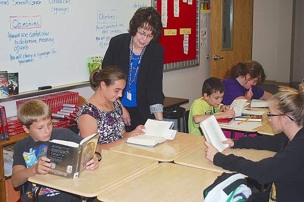 Churchill County Middle School English teacher Nancy Deutscher assists her students Thursday morning in her class. CCMS has earned a 4-star ranking from the Nevada Department of Education.