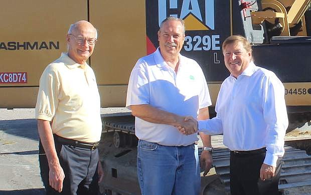 From left, Fallon Councilman Bob Erickson, Mayor Ken Tedford and Full House President and CEO Daniel R. Lee pose for a photo before the demolition of the office building begins.