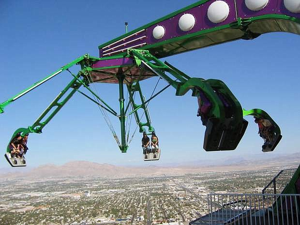 View of the Insanity ride, which tosses riders high above the Las Vegas