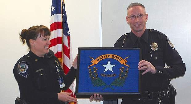 Maj. Susan Aller-Schilling presents a Nevada flag to Trooper Chuck Allen. The flag flew over the Nevada Highway Patrol's  Northern Command' headquarters on Nov. 26, 2014.