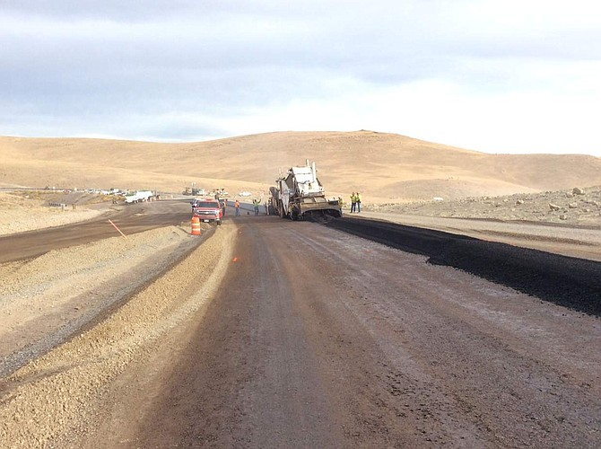 Paving has begun on the USA Parkway extension.