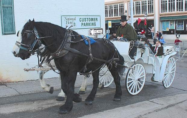 A horse-drawn wagon takes passengers for a short ride.