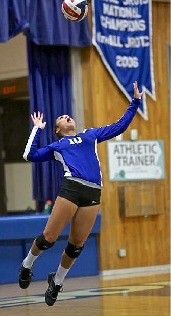 Junior Abby Paulson serves for the Senators Thursday evening against Spanish Springs.