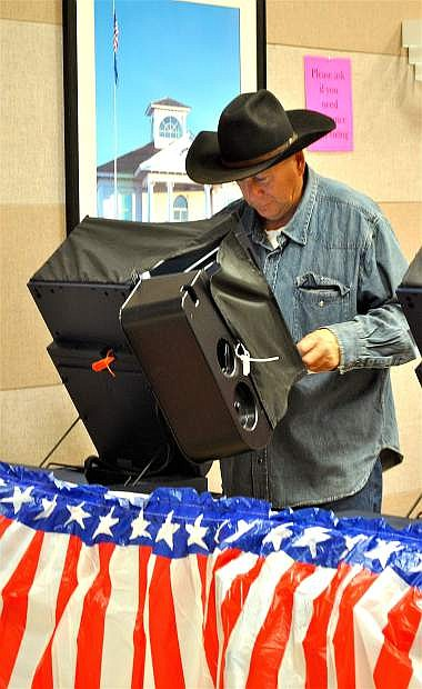 Tom Tijerino votes early on Monday afternoon, having brought his notated sample ballot with him to the Churchill County Commission Chambers. About 1,400 voters had shown up since early voting opened Saturday, said Deputy Clerk Erin Montalvo.