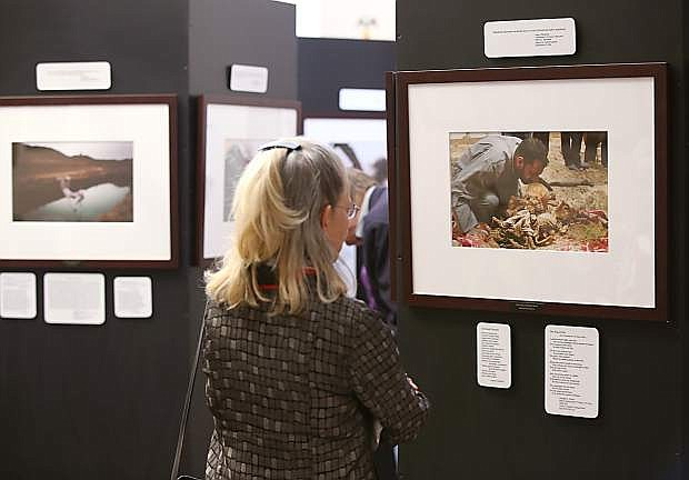 Visitors look at the Always Lost: A Meditation on War exhibit at the Legislative Building in Carson City, Nev., on Monday, April 6, 2015.