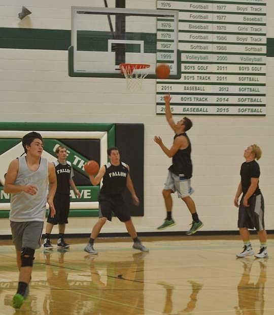 Connor Richardson, left, practices a post run drill with other members of the varsity basketball team.