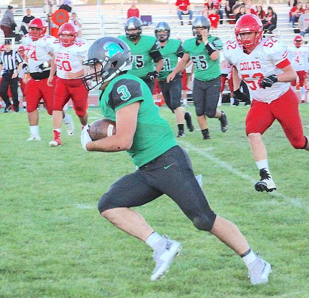 Connor Nelson picks up some yardage in the first quarter.