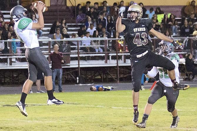 Fallon defensive back Dalton Kaady intercepts a Sparks pass and returns it for a 99-yard touchdown.