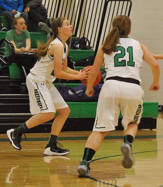 Fallon's Caitlyn Welch, left, and Zoey Swisher set up for a shot at the net in their first game of the season.