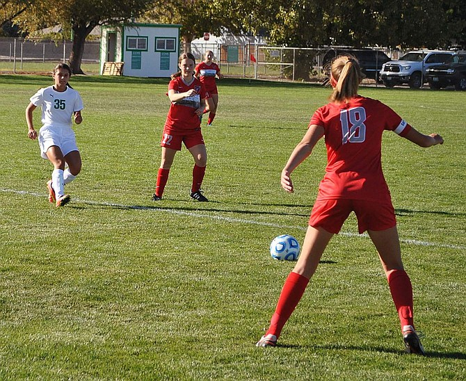 Fallon's Maddie Guerrero and Truckee's Lydia Christian face off over the ball.