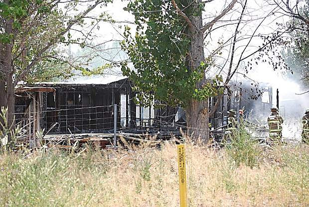 Firefighters from Fallon/Churchill and Naval Air Station Fallon's Federal fire departments responded to a fire on Wednesday that destroyed a trailer off of Wildes Road.