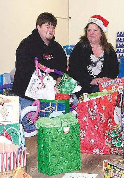 In this file photo, JD Nichols, left, and Dawn Ballard organize bags of toys