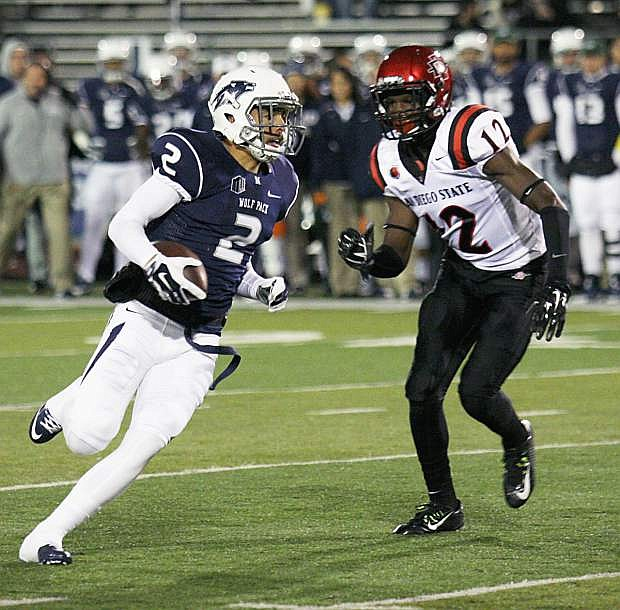 Nevada wide receiver Richy Turner runs down the field trying to beat San Diego State's Malik Smith.