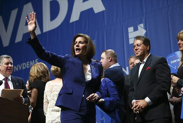 Sen.-elect Catherine Cortez Masto, D-Nev., waves to supporters after her victory at an election watch party in Las Vegas, Wednesday, Nov. 9, 2016. (AP Photo/Chase Stevens)