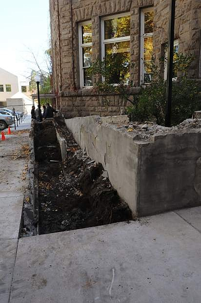 Workers continue to work on an ADA compliant ramp to enter the Capitol building in Carson City. The new ramp will be four feet wide upon completion, which is expected in mid-December.