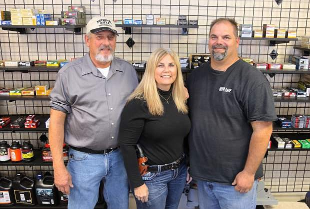Jim Scott, left, and his wife Kristy have become business partners with Rudy Hindelang, owner of Battle Born Ammunitions & Firearms.