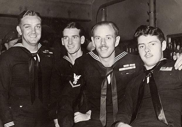 Jack Wolfe is the third handsome sailor from the left relaxing with three of his shipmates in the Pacific Theatre of Operations during World War II.