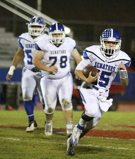 Carson quarterback Daniel Morrison looks upfield during a scramble in the second half of Friday's playoff loss to Reno.