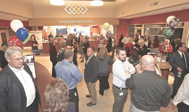 People gather Wednesday evening for United Federal Credit Union's Jack's Valley branch ribbon cutting. Dignitaries from Carson City, Douglas County and the Governor's office were onhand for the occasion.