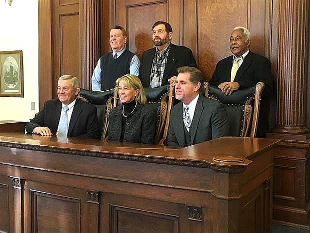 Justices of the Nevada Supreme Court pose with Secretary of State Barbara Cegavske in the old Supreme Court room at the Capitol after canvassing the General Election vote, making the results official on Tuesday.